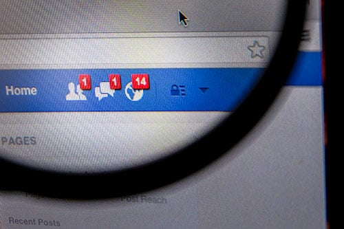 thailand september 2 2014 magnifying glass of facebook page friend message feed on browser Sw3ocgd3fl